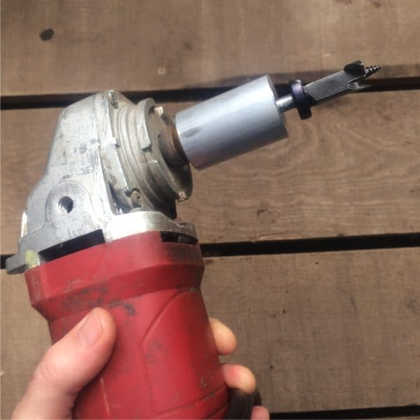 angle grinder with adapter and mushroom drill bit